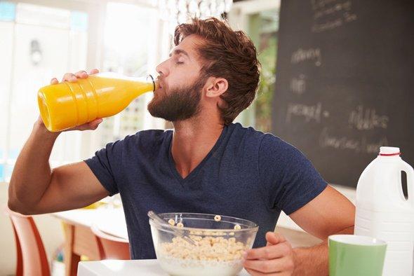 Young Man Drinking Orange Juice