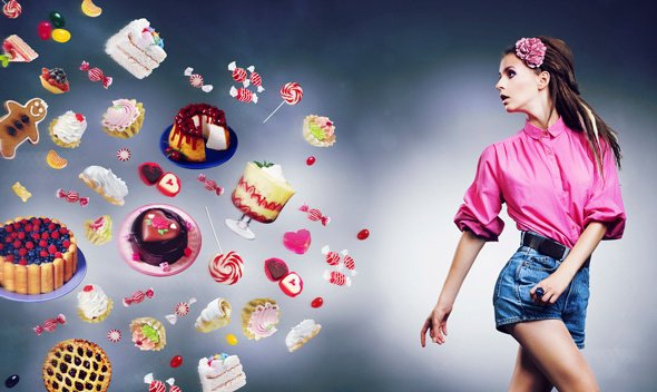 Young Woman Looking at Cakes and Candy Flying Through the Air